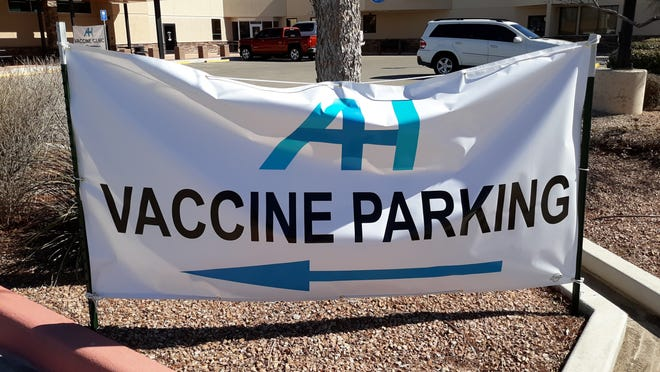 A banner at Artesia General Hospital shows where people can park before getting the COVID-19 vaccine. A community wide clinic was held in Carlsbad March 1, 2021 and more than 500 people received the vaccine.