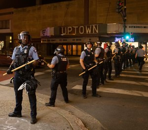In this June 5, 2021, file photo, Minneapolis police officers stand in formation after a vigil for Winston Boogie Smith Jr. in Minneapolis.
